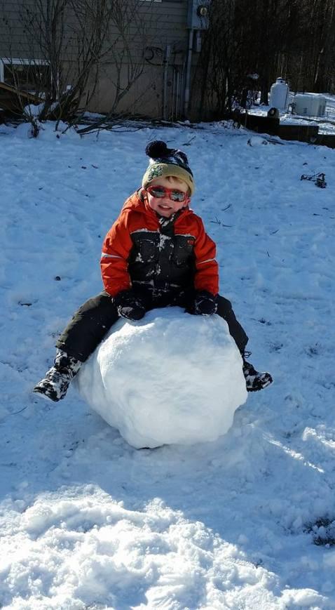 Quinlan making a snowman